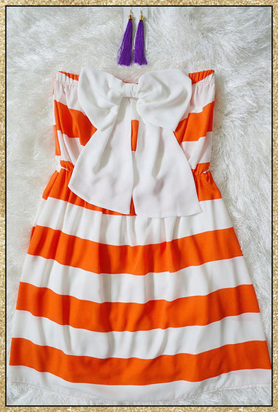 Strapless orange and white large striped short dress with large white bow on the front chest