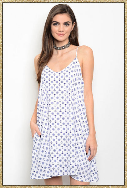 Off white and navy blue spaghetti strap dress with pockets