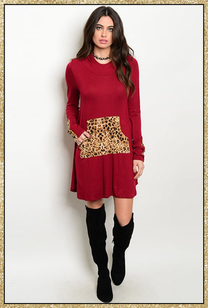 Long sleeve burgundy dress with cheetah print large pocket at the front waistline and cheetah print lining in the hood that is attached to the upper back