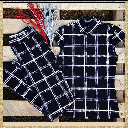 2 piece black and white large plaid print top and pants set with mock neck and caped sleeves