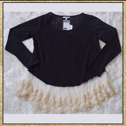 Dark charcoal long sleeve top with ruffled lace along the bottom
