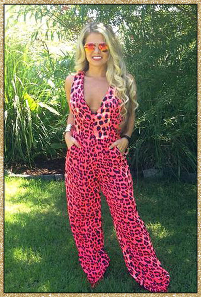 Pink and navy leopard jumpsuit with plunging v neck and criss-cross upper back design