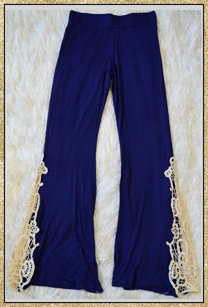 Navy blue palazzo flare bottom pants with crochet detail along bottom sides