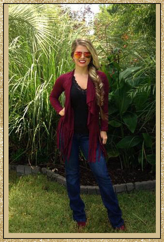 Wine long sleeve suede like cardigan with fringe trim along bottom