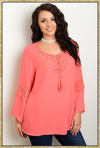Long belled sleeve plus size top with tassel tie on the front
