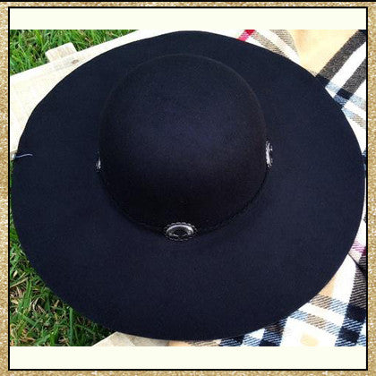 "Black floppy hat with ""belt"" design around top"