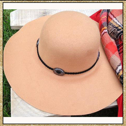 "Camel floppy hat with ""belt"" design around top"