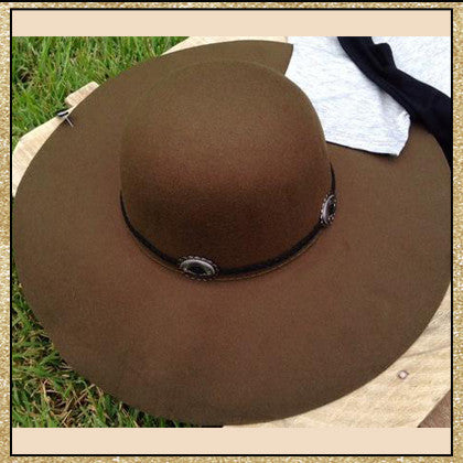 "Dark olive floppy hat with ""belt"" design around top"