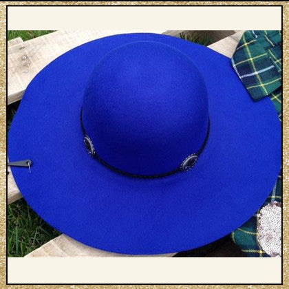 "Royal blue floppy hat with ""belt"" design around top"