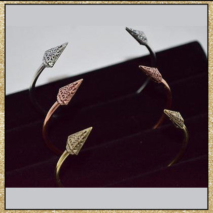 Silver, copper and gold open bangle bracelets with arrom design on ends