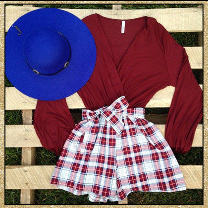 Burgundy long sleeve plaid romper with a tie bow on the waist an v neckline