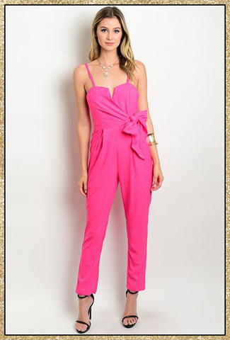 Hot pink spaghetti strap jumpsuit with large bow tie on side of waist