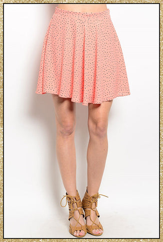 Salmon colored short skirt with a speckled design