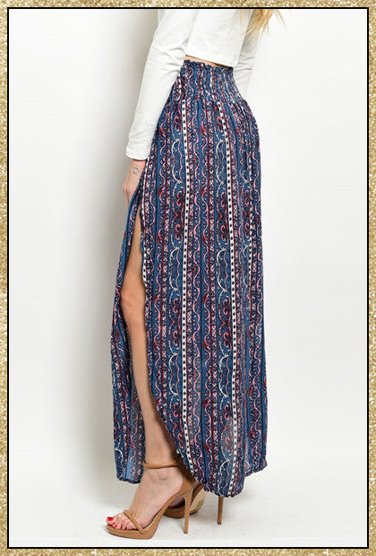 Long blue maxi skirt with multi-colored design and slits up both sides