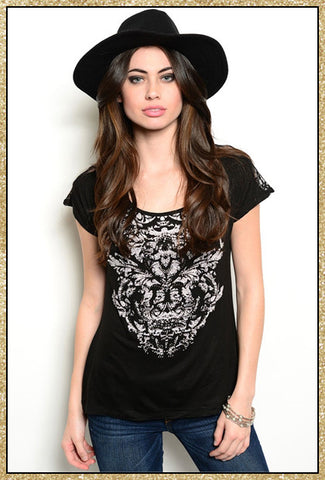 Black short sleeve top with white and rhinestone design on the front and a lace design on the upper back