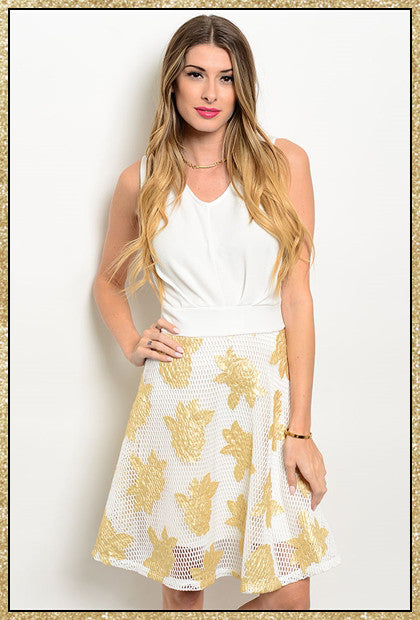 Sleeveless white dress with mesh overlay and gold rose patches