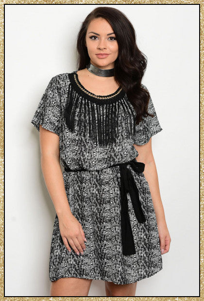 Black and white plus size dress with fringe along neckline and tie around waist