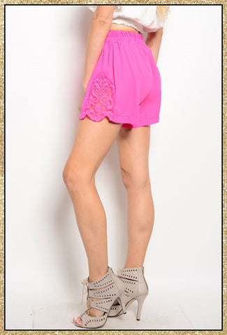 Hot pink shorts with elastic waist and crochet details on the sides