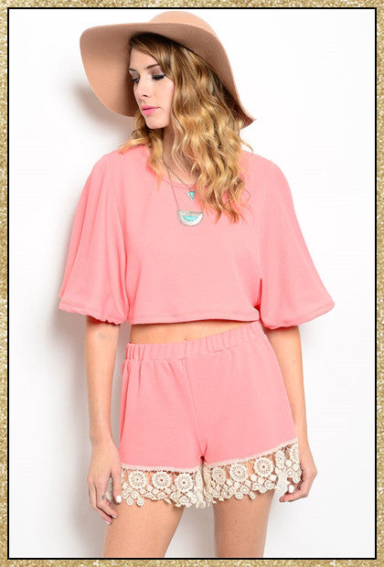Pink 2- piece short sleeve top and shorts set with crochet trim along the bottom of the shorts