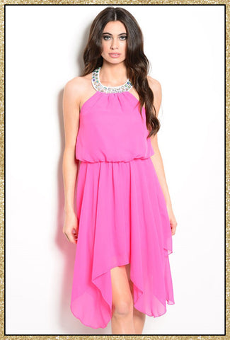 Hot pink halter top dress with rhinestone details along neckline and asymmetrical draping on bottom