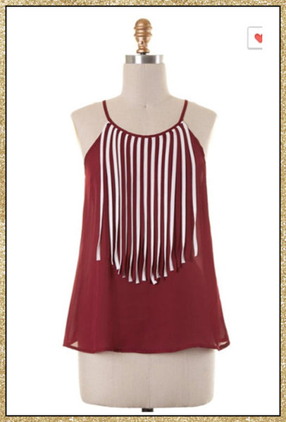 Garnet sleeveless lightweight top with white and garnet fringe hanging from the neckline down the front