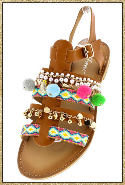 Tan multi-colored charm pom pom ankle strap sandals