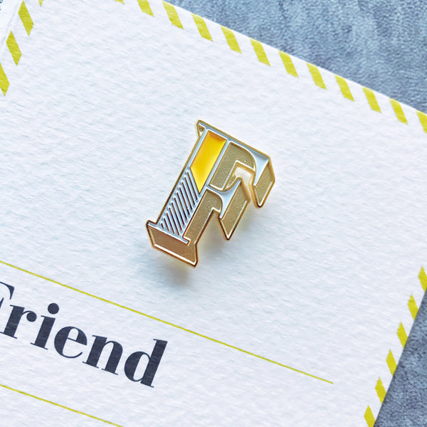 enamel letter F pin badge with card