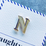 enamel pin badge with letter N and card