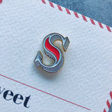 letter pin brooch