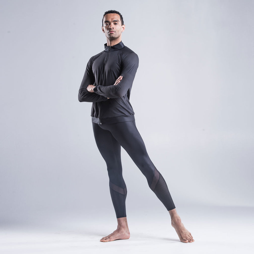 Brandon Lawrence mens collection wearing  Black leggings in sustainable fabric by Econyl. Also wearing black zip front jacket