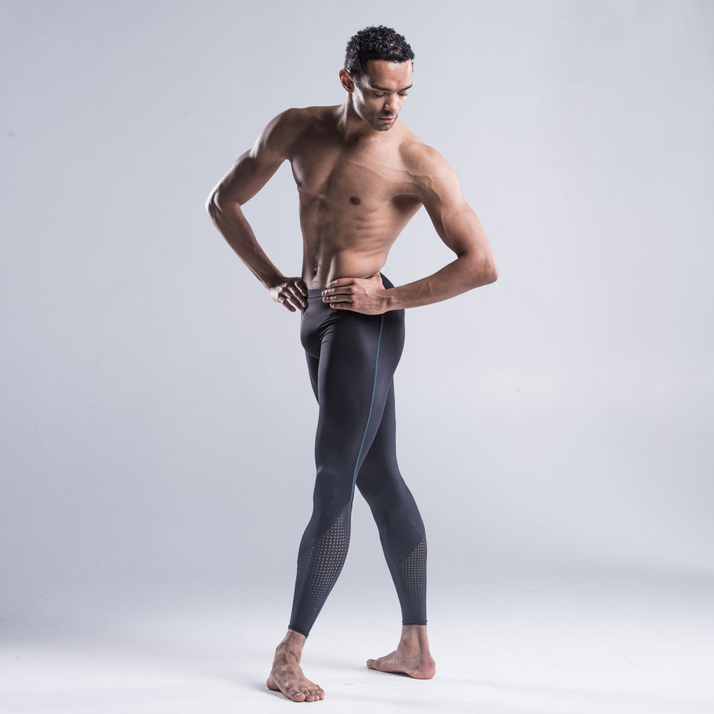 Brandon Lawrence wearing black dancer tights with a perforated bottom section highlights the calf muscle and extends the leg line combined The contrast green stitch down the side of the leg coordinates with other garments in the collection