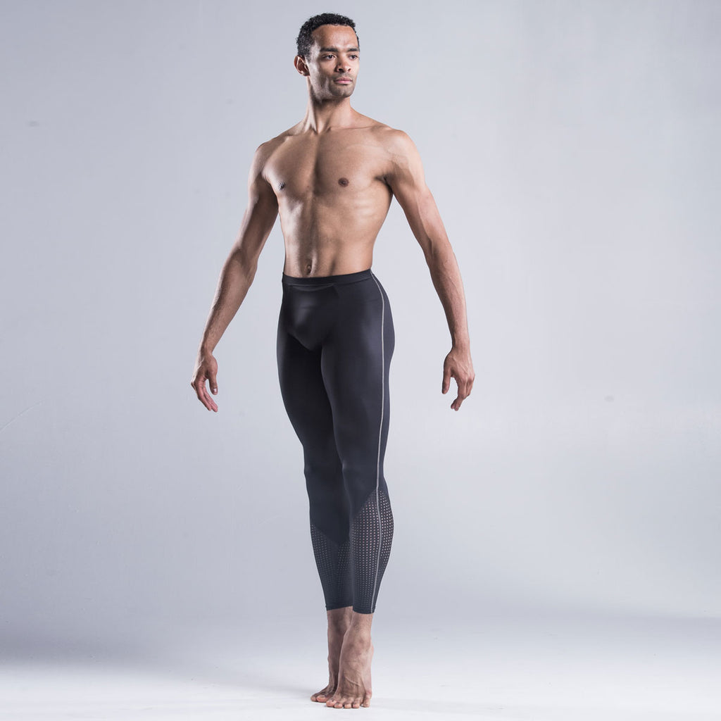 Brandon Lawrence wearing black dancer tights with a perforated bottom section highlights the calf muscle and extends the leg line combined The contrast stitch down the side of the leg coordinates with other garments in the collection