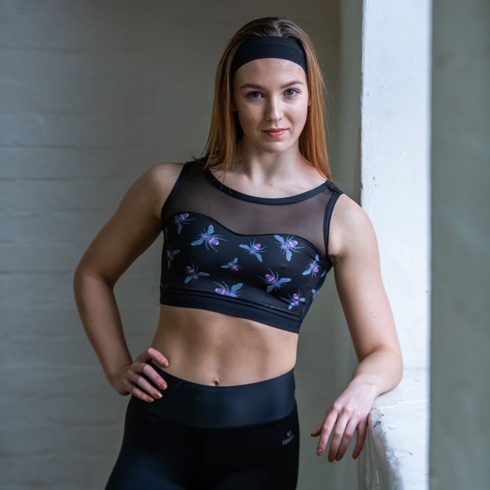 stylish and popular dance top is now available in our exclusive NEW Bee print.  Double layered front for additional support  Stunning open back design  Snug midriff band keeps the top in place   Sheer Power Mesh for cooler feel  Made with sustainable and regenerated planet friendly fabrics