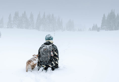 winter hat dog owner snow Canada