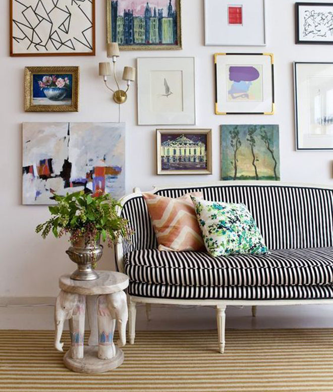 Black and White Striped Couch with Colorful Gallery Wall