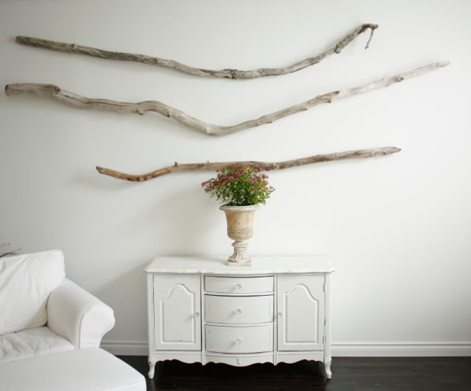 Minimalist Driftwood Wall Art above Antique White Console Table