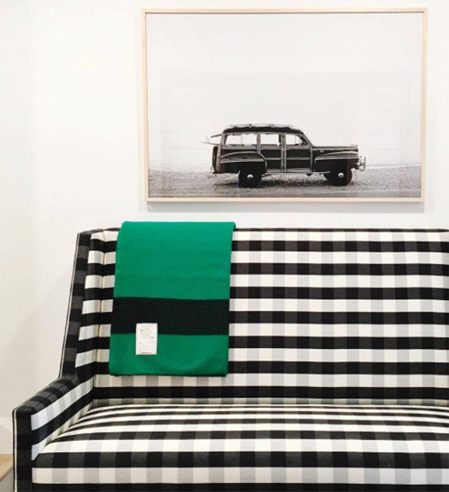 Black and White Plaid Sofa with Photograph