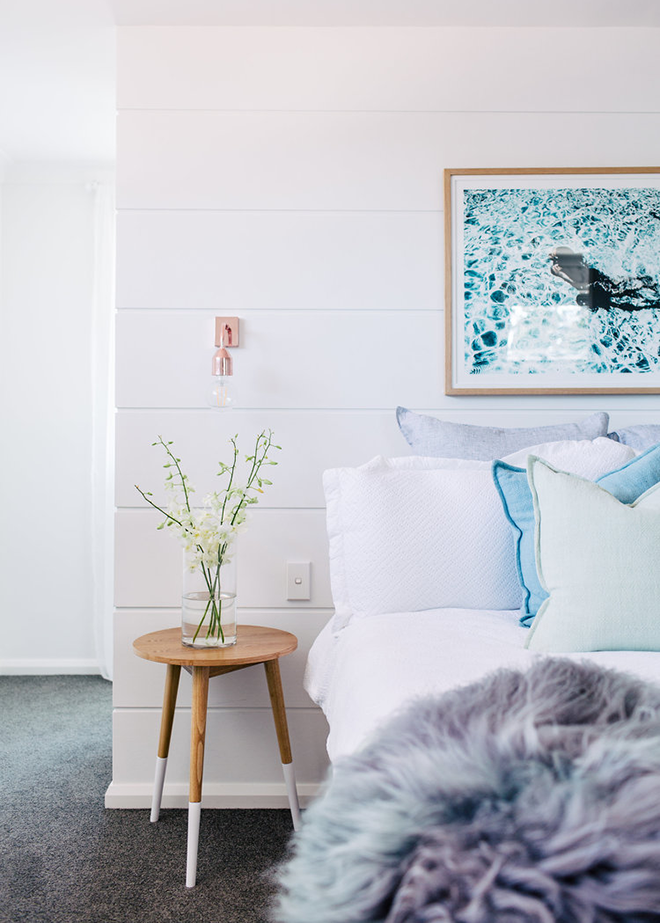 White and Gray Bedroom with Turquoise Ocean Photograph Art