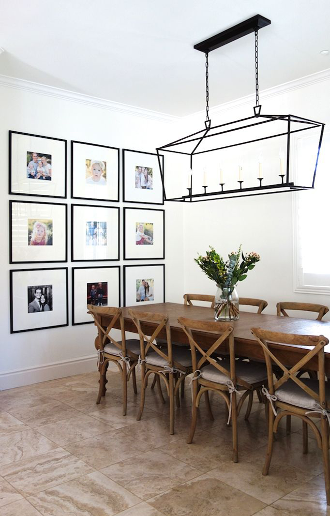 Symmetrical Gallery Wall of Color Family Photos in Dining Room
