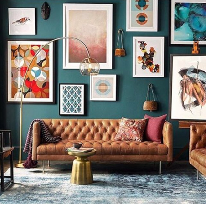 Deep Teal Painted Wall with Gallery Art and Modern Sofa
