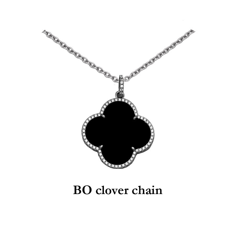 Sterling Silver Black Onyx Clover Pendant with cubic zirconias