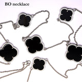 Sterling Silver Black Onyx Clover Necklace with cubic zirconias
