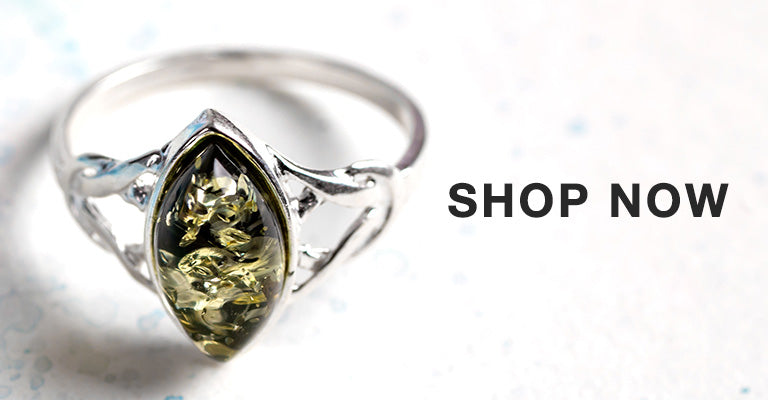 Green Amber Celtic Ring - North/South | Shop Now!