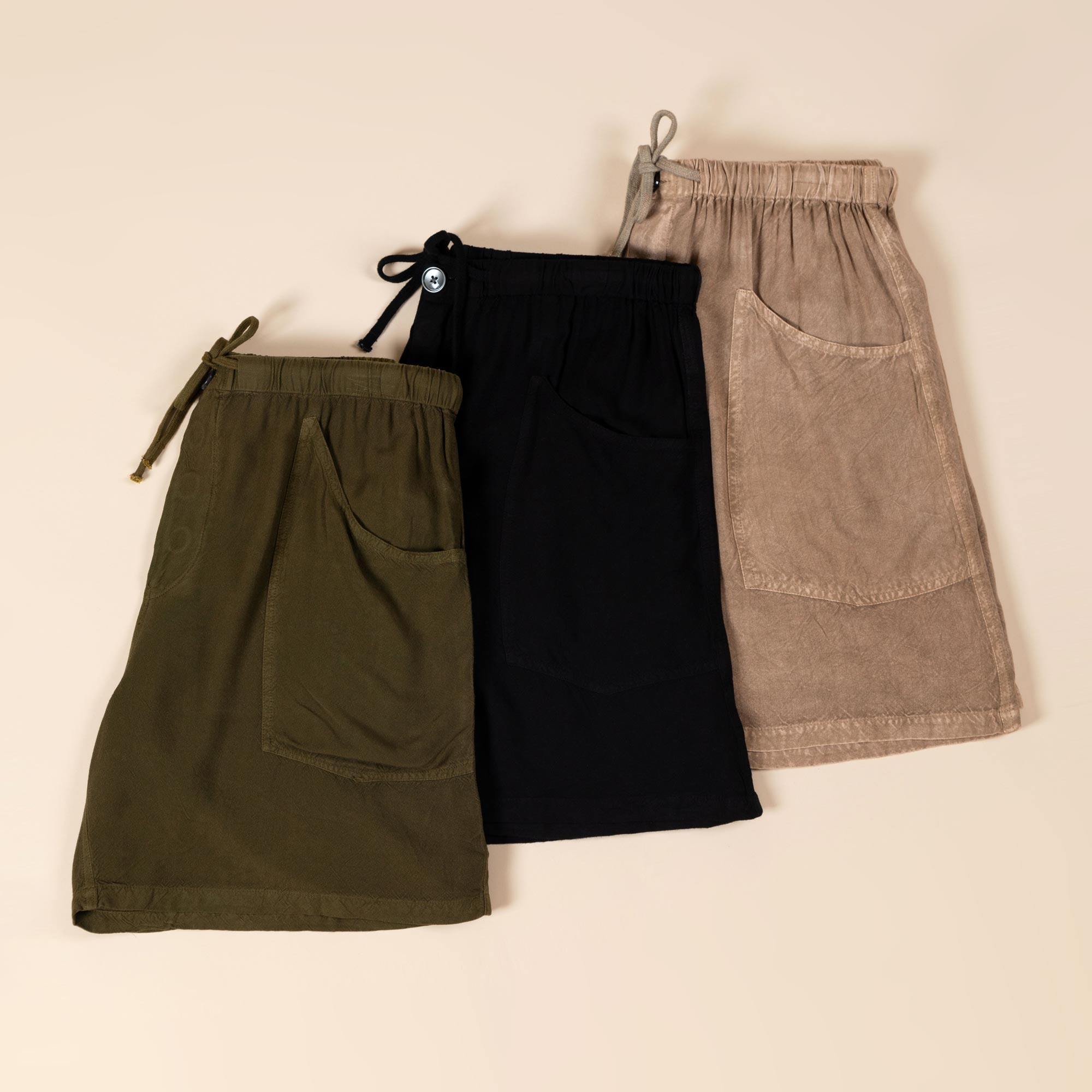 Three pair of solid-colored earth tone shorts