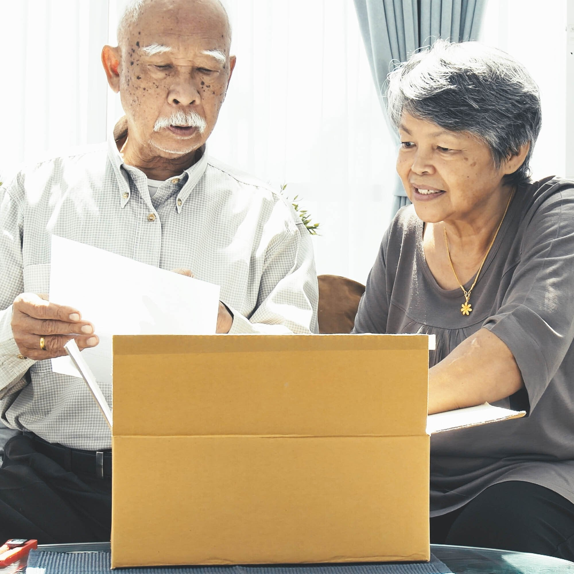 Man and woman open box of supplies