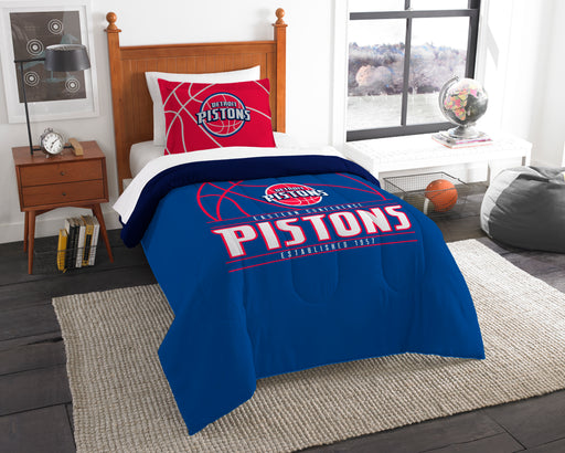 "Pistons OFFICIAL National Basketball Association, Bedding, """"Reverse Slam"""" Printed Twin Comforter (64""""x 86"""") & 1 Sham (24""""x 30"""") Set  by The Northwest Company"