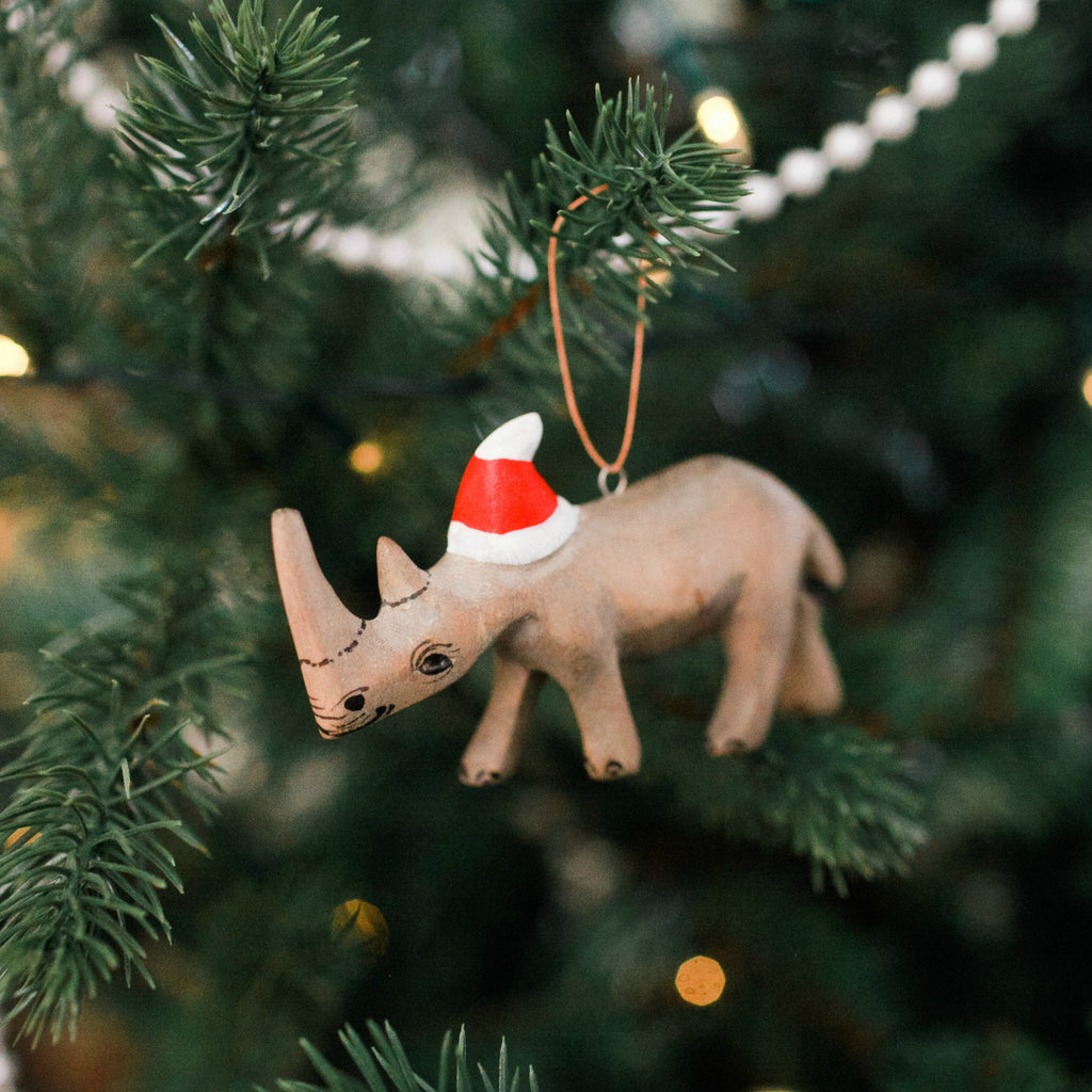 Handcarved Rhino Ornament with Santa Hat