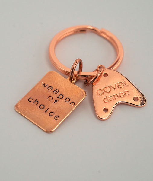 Covet Dance logo on the back of rose gold charm