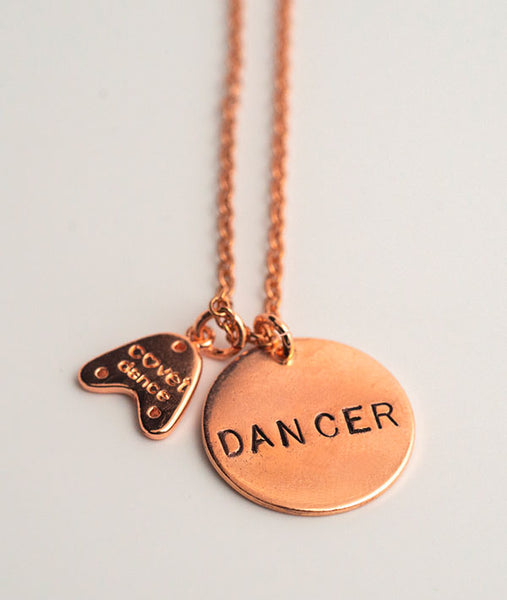 Covet Dance logo on back of charm