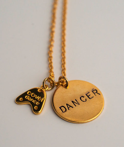 Back of tap charm has Covet Dance logo